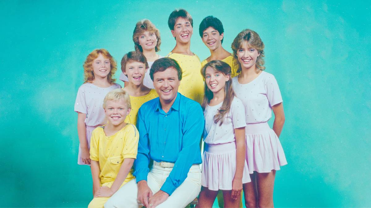 Young Talent Time host Johnny Young with the team in the pastel-hued 1980s. Picture: National Film and Sound Archive