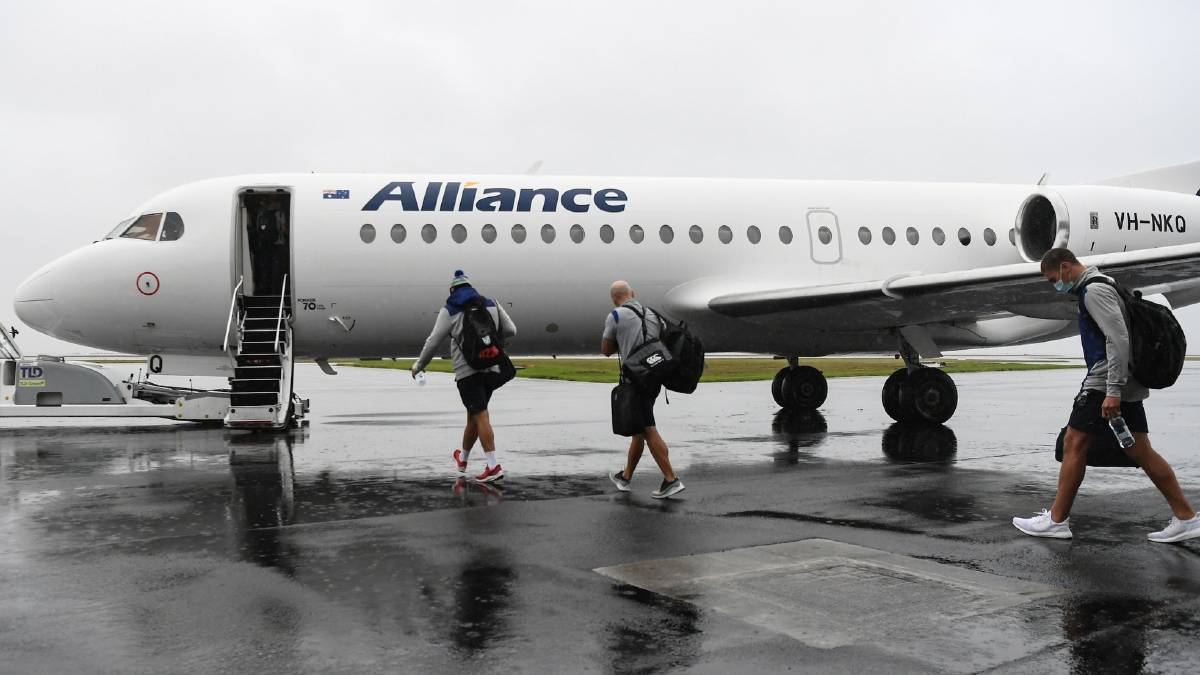 En route: The players and support staff board the plane in Auckland on Sunday. Photo: Vodafone Warriors