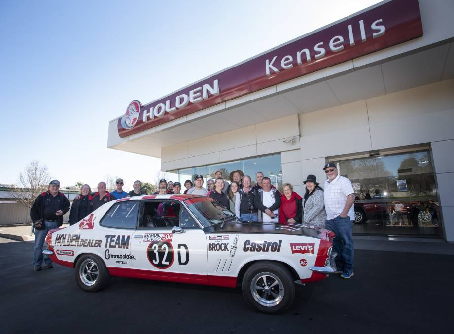 GONE NOT FORGOTTEN: Holden Car Club members and Holden enthusiasts met at Kensells' dealership on Saturday for one last photo before the signs get taken down. Photo: Peter Hardin