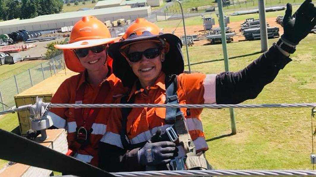 ENERGY: 2019 Tamworth based apprentice, Brianna, with an Essential Energy trainer. Photo: Supplied