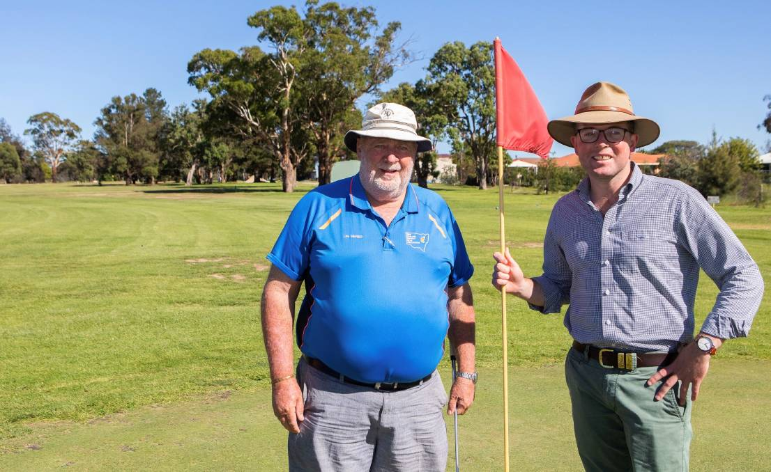 FORE: Uralla Golf Club president Darrell Carson celebrates his club's grant funding with Northern Tablelands MP Adam Marshall. Photo: Supplied