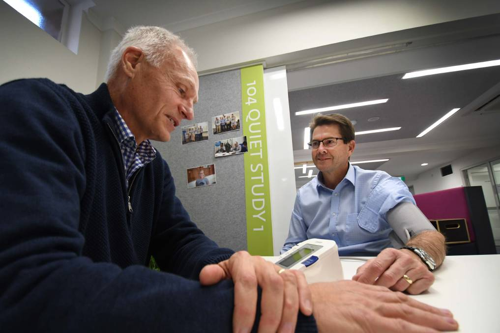 Life-saver: Peter Annis-Brown checks Kevin Anderson's blood pressure as he launches his new health app PromptMate during Men's Health Week. Photo: Gareth Gardner