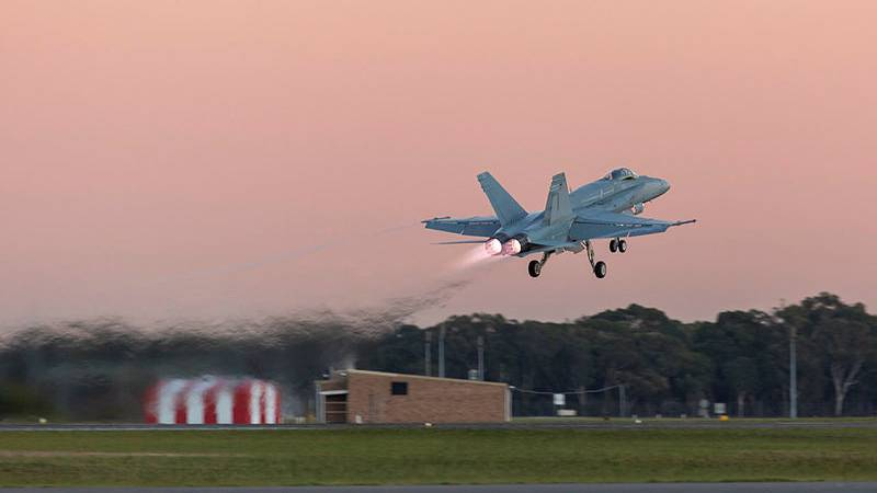 A single F/A-18B Classic Hornet aircraft will take to the sky tonight. Photo: SGT David Gibbs, Commonwealth of Australia, Department of Defence