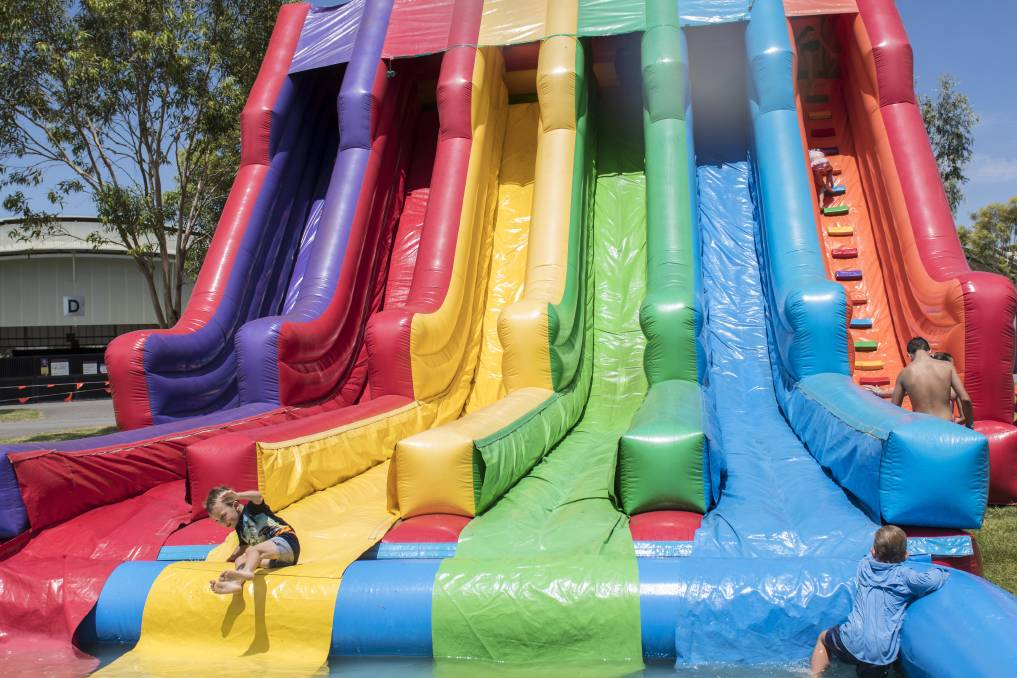 FUN: The inflatable water slides were popular last year but a lack of water will mean they won't be back in 2020. Photo: Peter Hardin