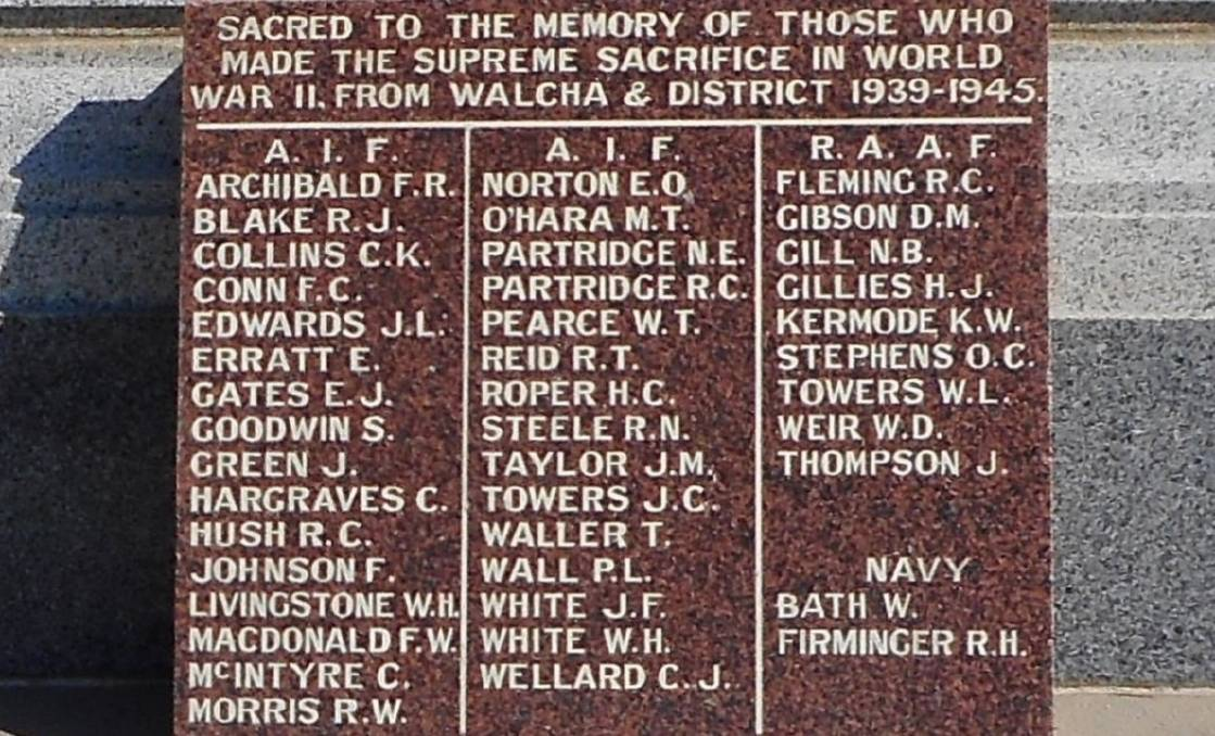 Slice of history: The panel added to the monument in the Walcha War Memorial Park after the end of World War II.