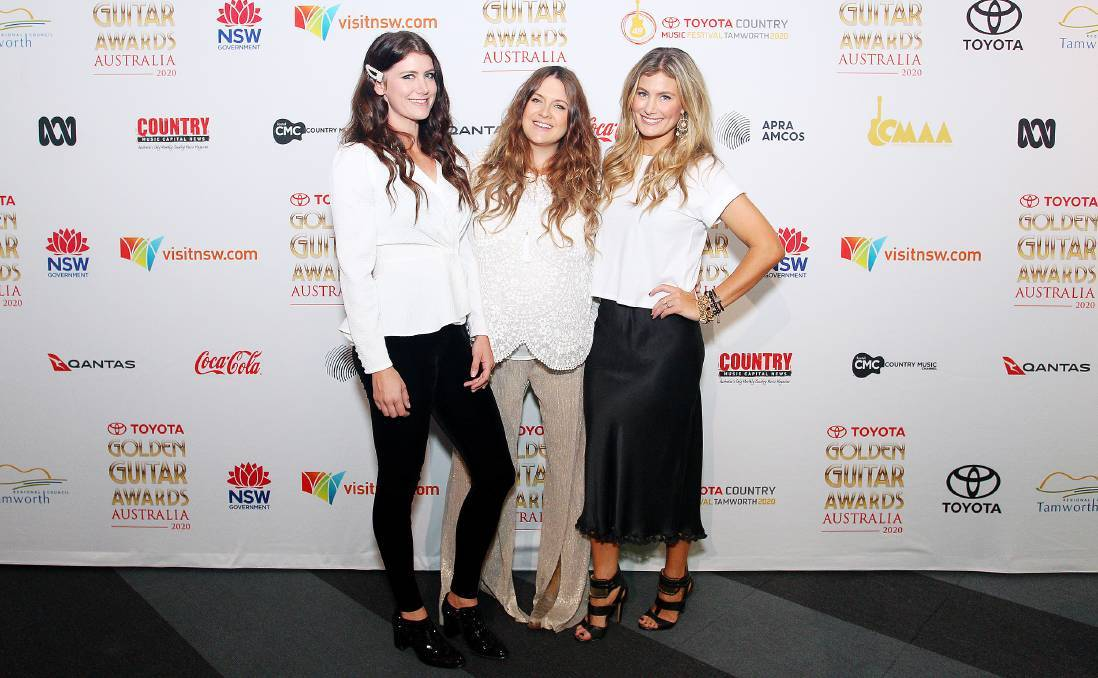 GO GIRLS: The McClymont sisters - Mollie, Brooke and Sam - will perform at the Golden Guitar Awards 2021. Pictured at the nominee announcement for last year's ceremony. Photo: Peter Hardin