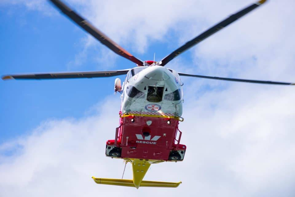 TOUGH RESCUE: The Westpac Rescue Helicopter winched a 25-year-old man from rugged terrain after he fell three metres. Photo: WRHS