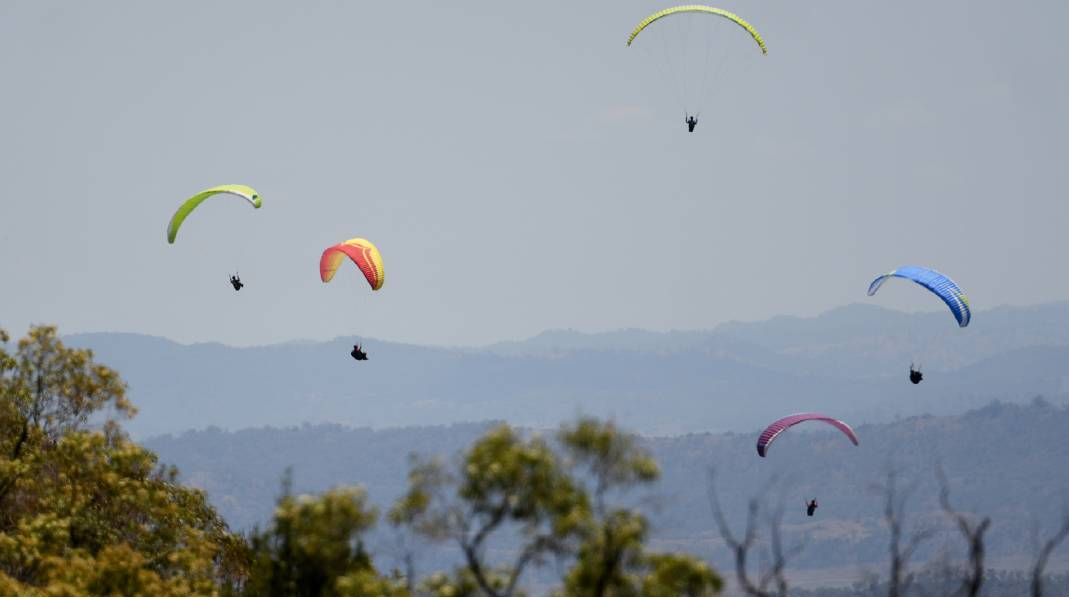 Bids-eye view: Paragliders are set to once again make a colourful sight in the skies over the region with the Manilla XC Camp getting underway on Saturday. Photo: Gareth Gardner