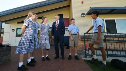 BUILDING BOOM: Calrossy Anglican School principal David Smith with Calrossy students out the front of the first new building. Photo: Gareth Gardner