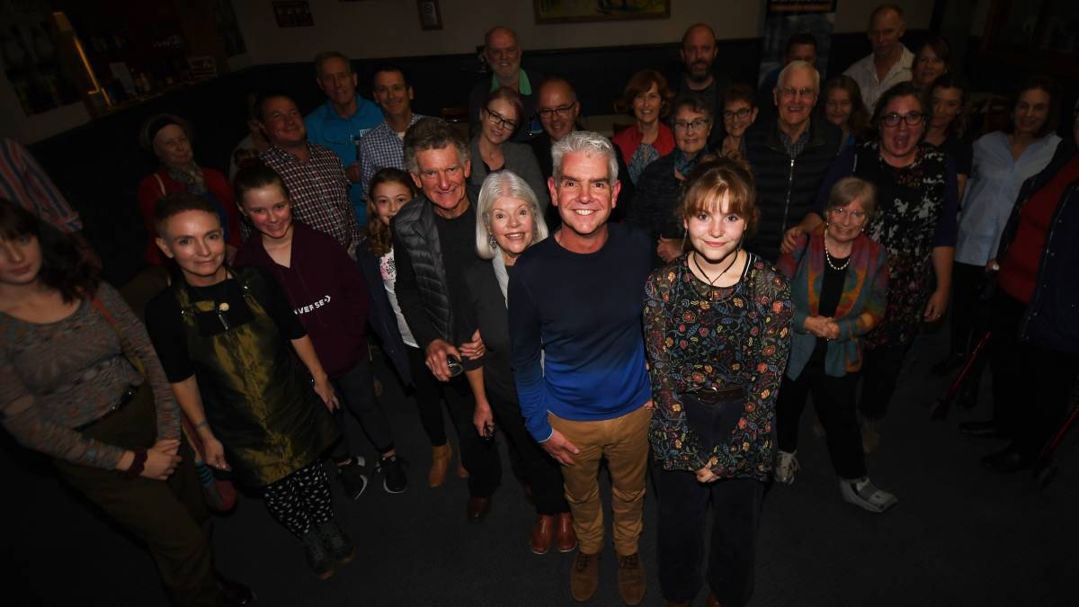PROUD BUT PERPLEXED: Adam Blakester flanked by his supporters on election night. Photo: Gareth Gardner