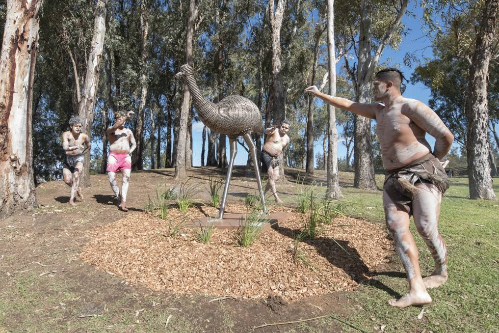 PRIDE OF PLACE: Gomeroi dancers welcome the Dhinawan sculpture to the park. Photo: Peter Hardin 050719PHC125