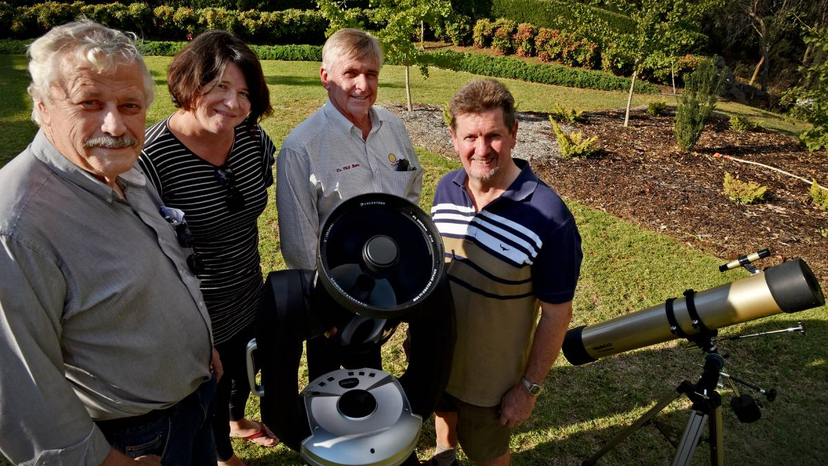 STARS IN THEIR SCOPES: Tamworth Regional Astronomy Club members Garry Copper, Kate Daley, Phil Betts and Steve Rogers see a bright future for astronomy in our region. Photo: Geoff O'Neill 120416GOF02