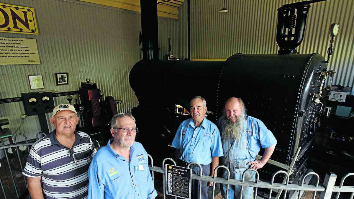 READY TO RUMBLE: Tamworth Powerstation Museum will have its John Fowler steam engines firing for visitors to see on Friday and Saturday. From left,  retired boiler operator visiting from Gladstone, Qld, Allan Pease, Powerstation volunteer Chris Lowe with steam engine operators Arthur Ruttley and Steve Bailey. Photo: Gareth Gardner 210116GGB05