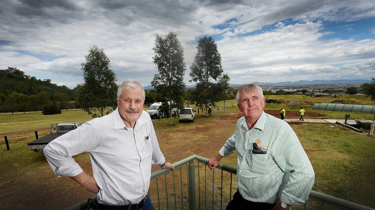 TAMWORTH CLUB: Vice-president of the Tamworth Regional Astronomy Club Garry Copper, left, with its publicity officer and Tamworth regional  councillor Phil Betts on the site earmarked for an astronomy centre. Photo: Gareth Gardner 171215GGB02